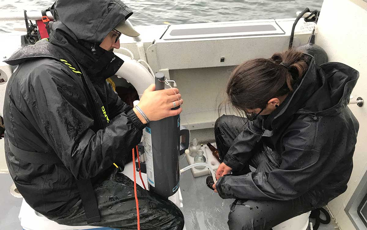Tsleil-Waututh Nation Natural Resource Technicians collecting water samples in Indian Arm